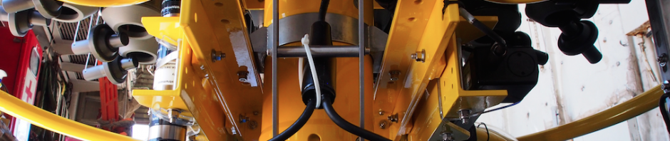 An instrument used for ocean sampling is mounted to a conductivity temperature and depth device. Photo by Andrew McDonnell.