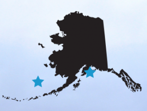 Blue stars represent the mooring locations: M2 in the Bering Sea and GAKOA in the northern Gulf of Alaska.