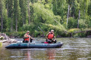Research technicians floating down Chena River